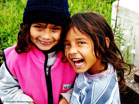 image of two girls grinning