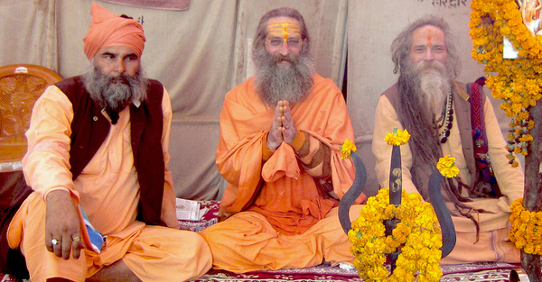 Baba Rampuri giving blessings; joined by his guru bhais, Dev Puri, and Mangalanand  Puri (Goa Gil) at his dhuni during recent Kumbh Mela at Allahabad (2013)