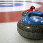 20121210171544-curling_stones_on_rink_with_visible_pebble